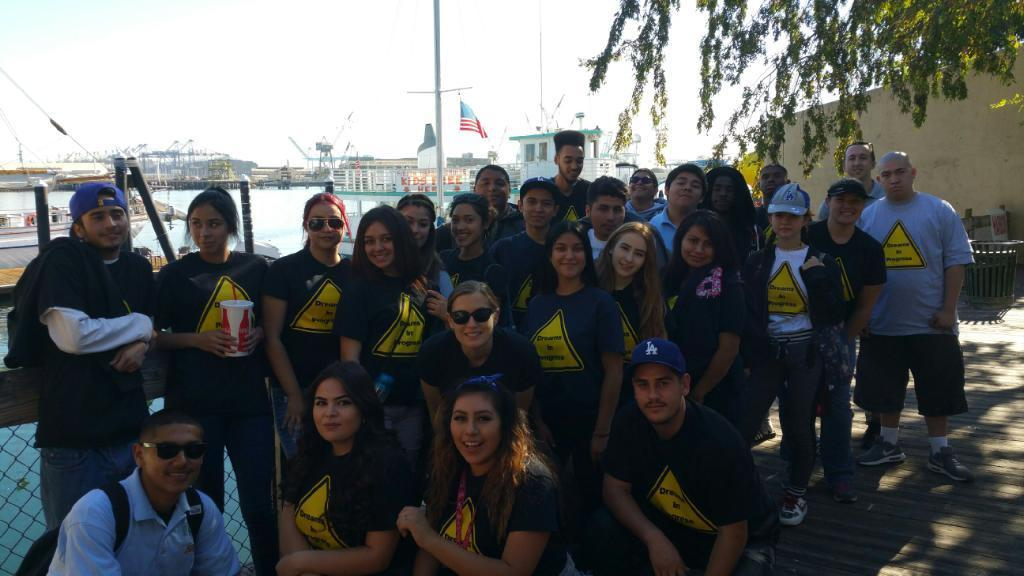 Norwalk students pose outside a sailboat