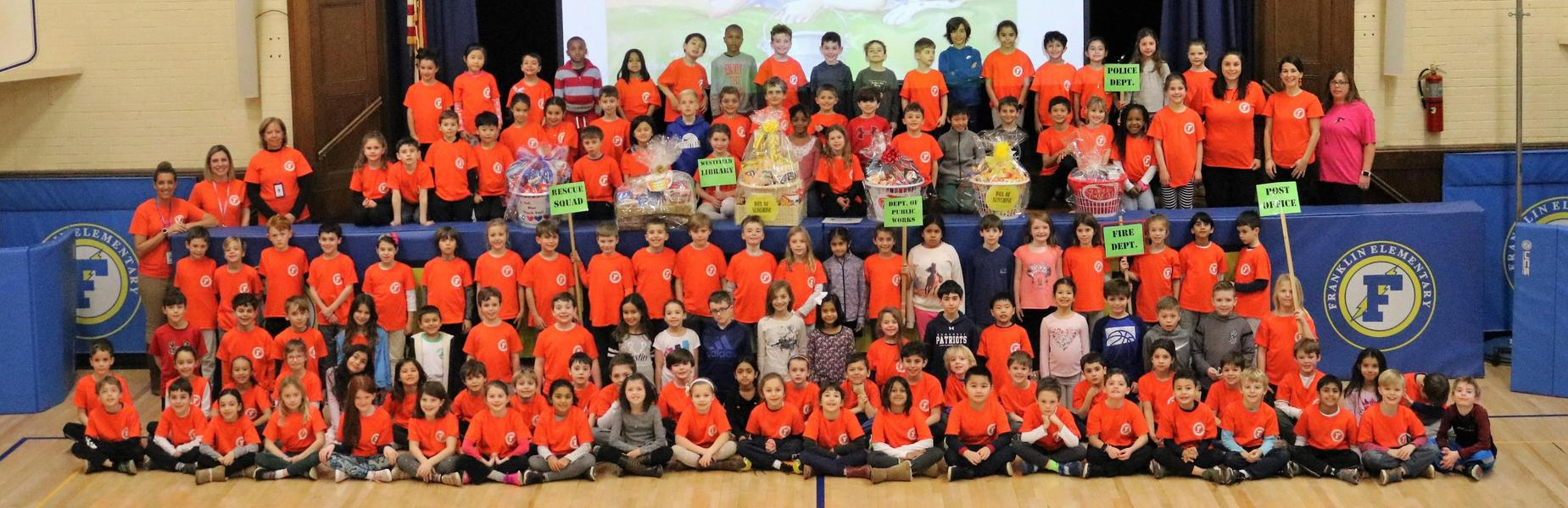 Franklin School 2nd graders participate in Kindness Month by creating baskets filled with necessary items for local emergency responders.  Pictured here is the entire 2nd grade class and their teachers.