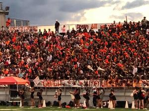fans in orange and black