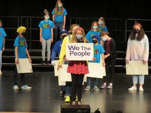 TK Middle School students sing a song in the show.