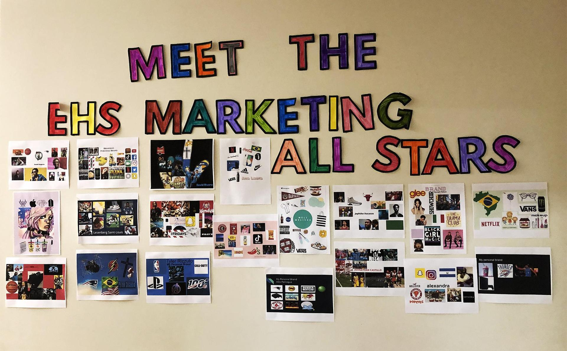 A wall of design work done by marketing students