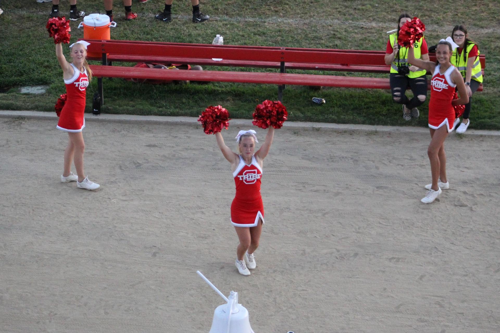 Junior Varsity Cheer in action at the Mendota football game