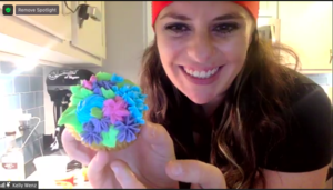 Ms. Wenz showing her cupcake on zoom