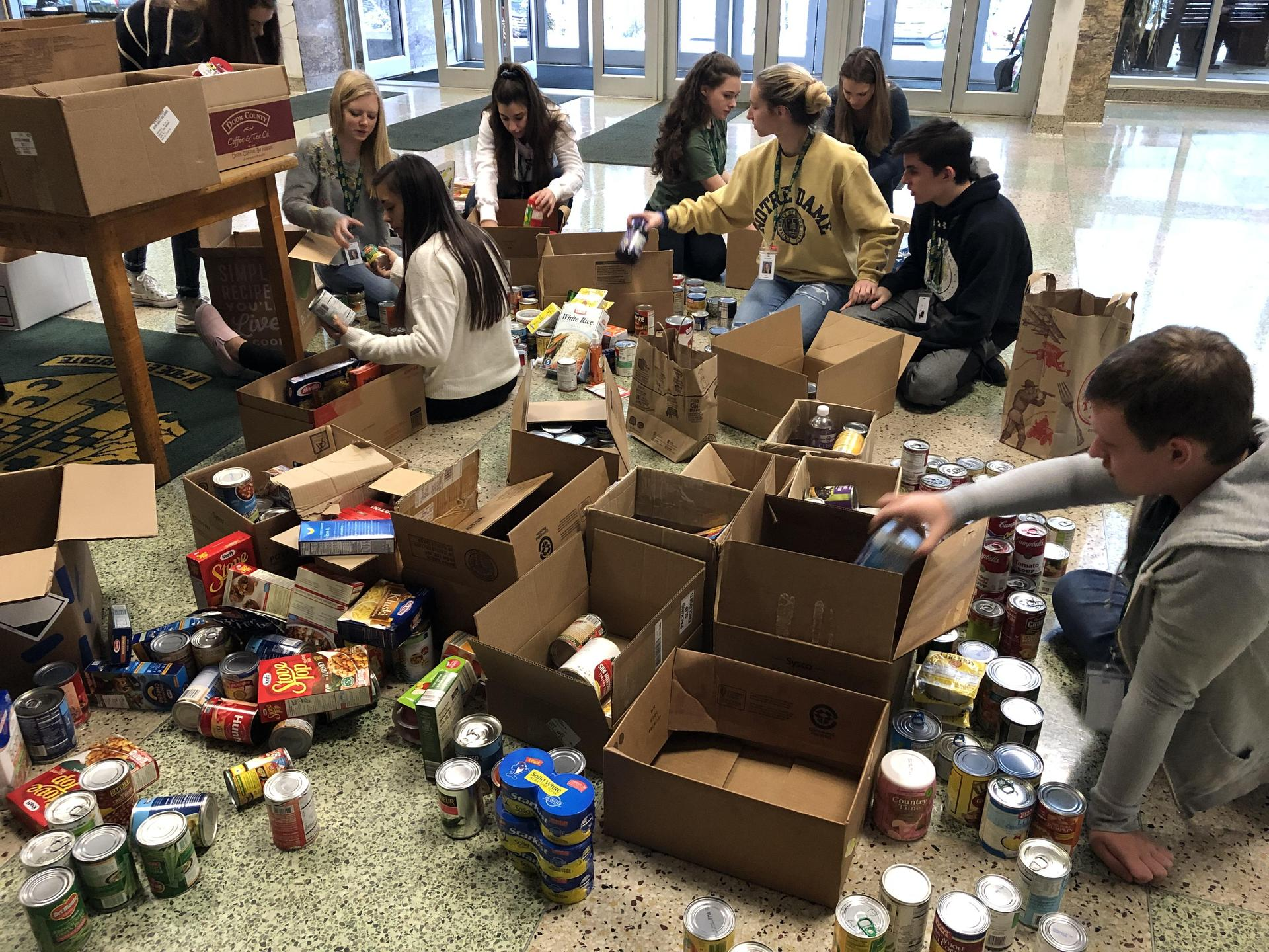 Students help with pack up items for the annual Thanksgiving Food Drive