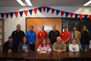 Skylar Nickel signing letter of intent to play soccer at Lewis and Clark Community College