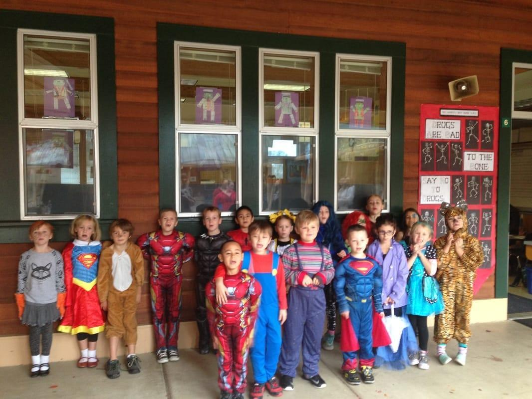 Class photo wearing their Holloween costumes