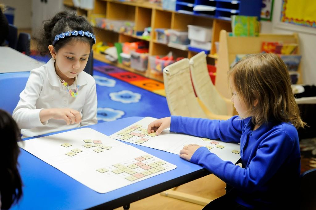 girls playing an alphabet game