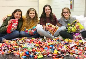 """Mars Area Middle School seventh-graders Katherine Detisch, Addison Terzich, Brooke Franklin and Paige Ditson organized the school's FOR (Friends of Rachel) Club """"Sweets for Soldiers"""" candy collection."""