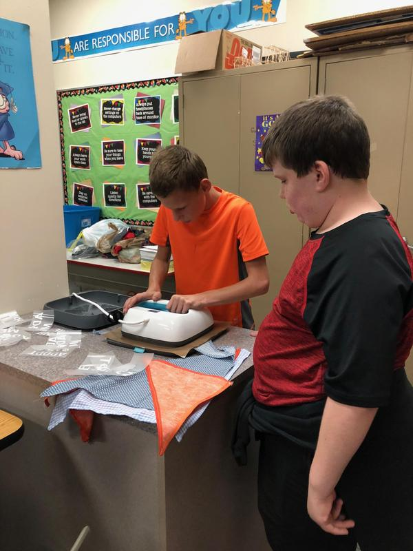 student using heat press to make bandana