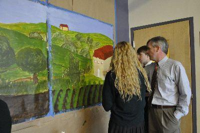 William O'Connor instructs students with their art project