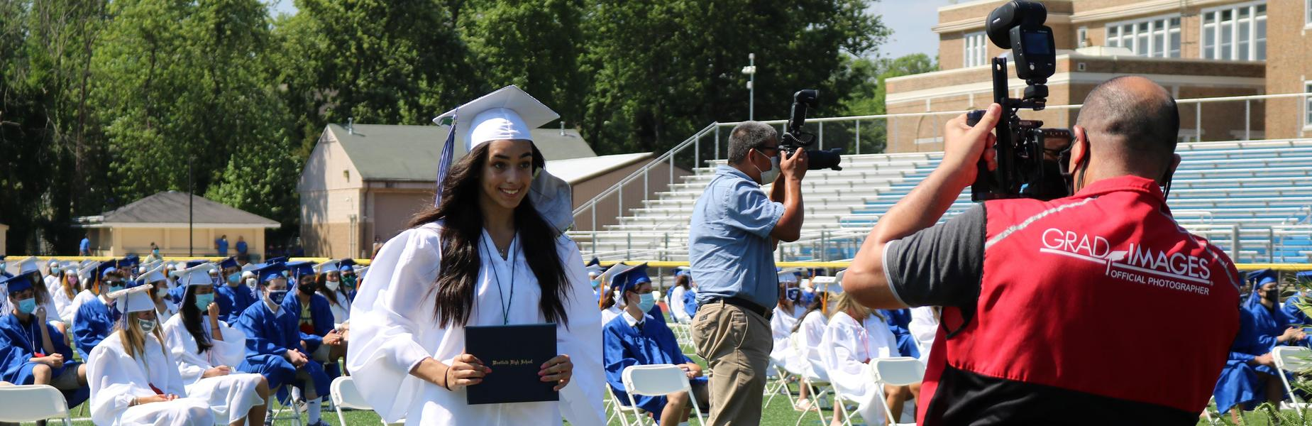 Photo of WHS senior posing for picture at graduation for Class of 2020.
