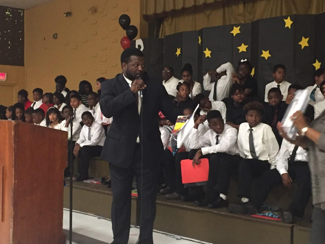 Another photo of Baker Middle Principal Roy Walker encouraging and welcoming graduating fifth graders from Bakerfield and Baker Heights