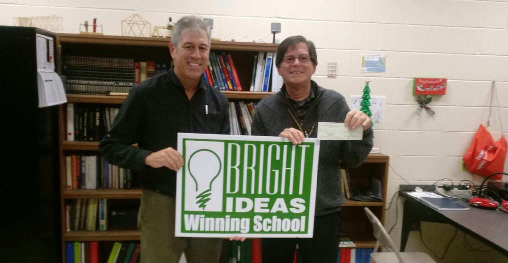Dr. Cadle accepting his check for winning the Bright Ideas Grant