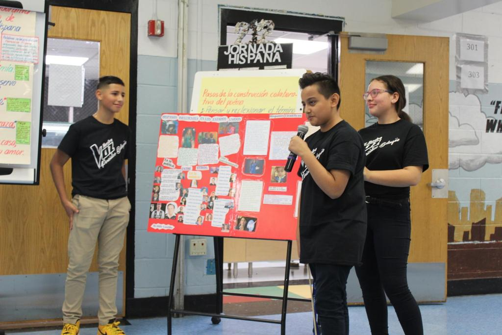 three students explaining their research findings