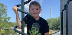 Boy on playground equipment