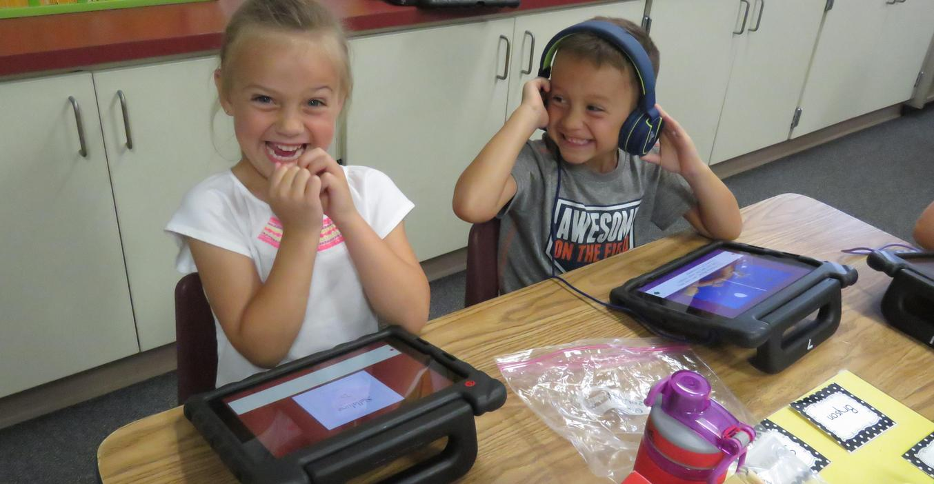 Students are happy to see friends in class.