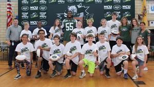 "New York Jets linebacker Lorenzo Mauldin visits Edison Intermediate School on May 4 to congratulate the school's ""Jets Upstanders of the Week."""