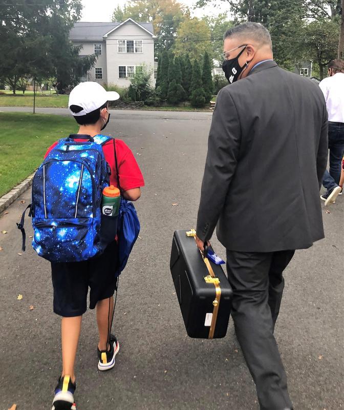 Westfield Superintendent Dr. Raymond González escorts Jefferson 4th grader Owen Hennes to school in celebration of Walk to School Day on Oct. 6.