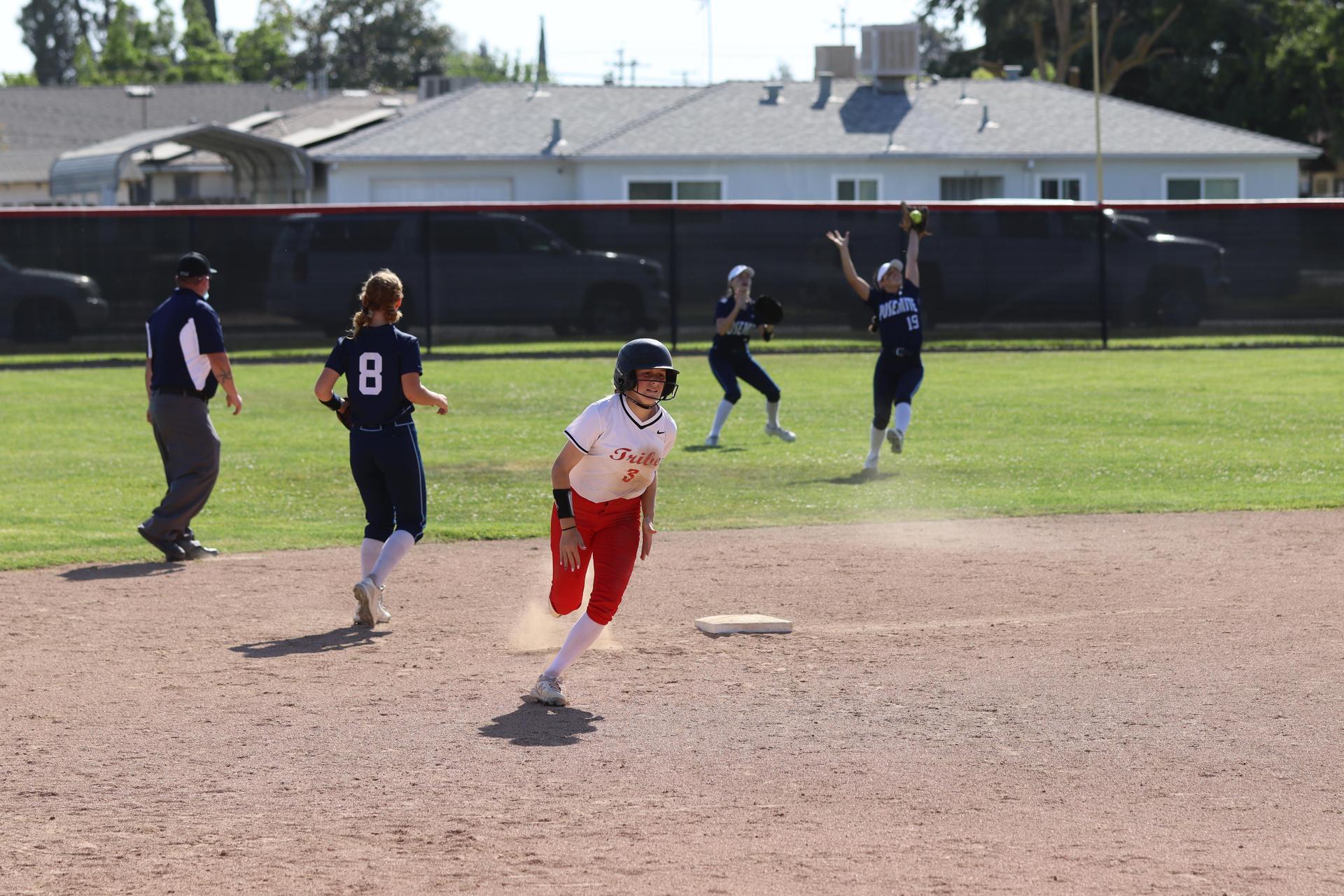 Girls playing softball vs Yosemite
