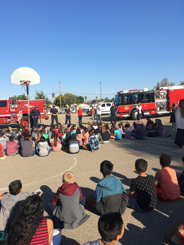 Students listening to firemen and learning about fire saftey.