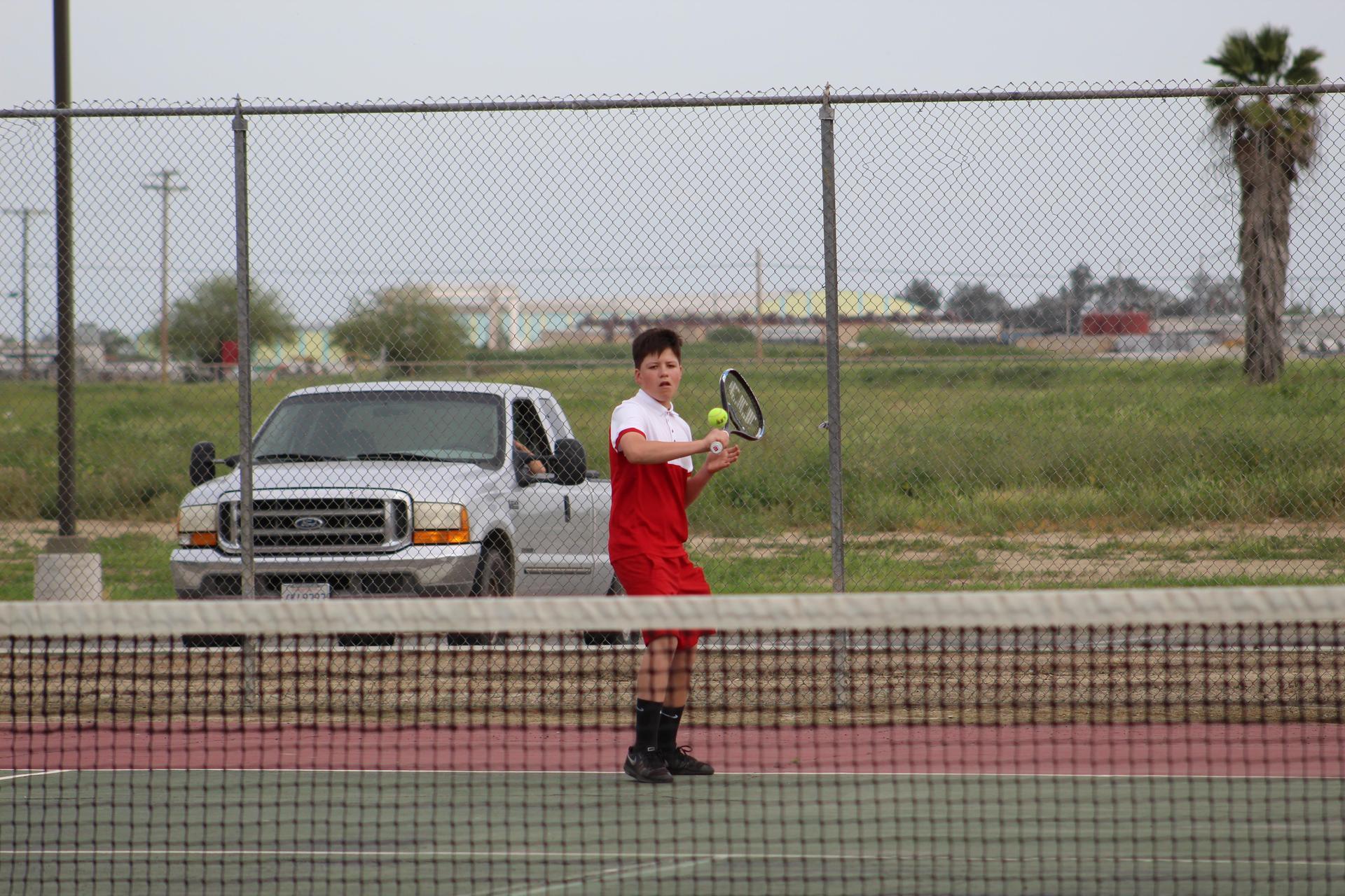 Boys playing tennis against Washington Union