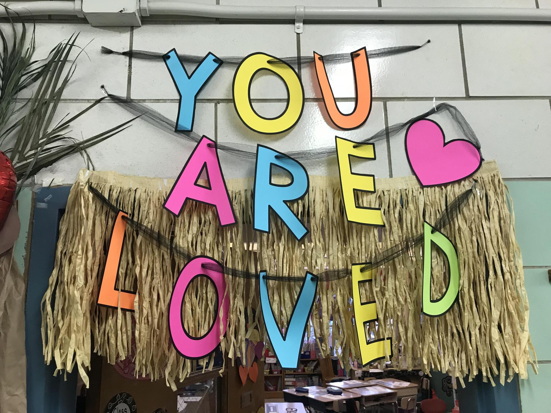 door decoration with messages of kindness for PS I Love You Day