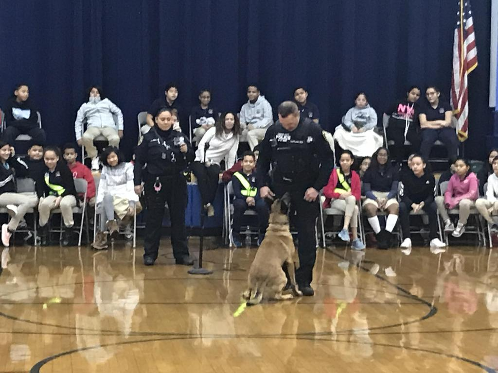 UC police officers with the dog sitting in the assembly
