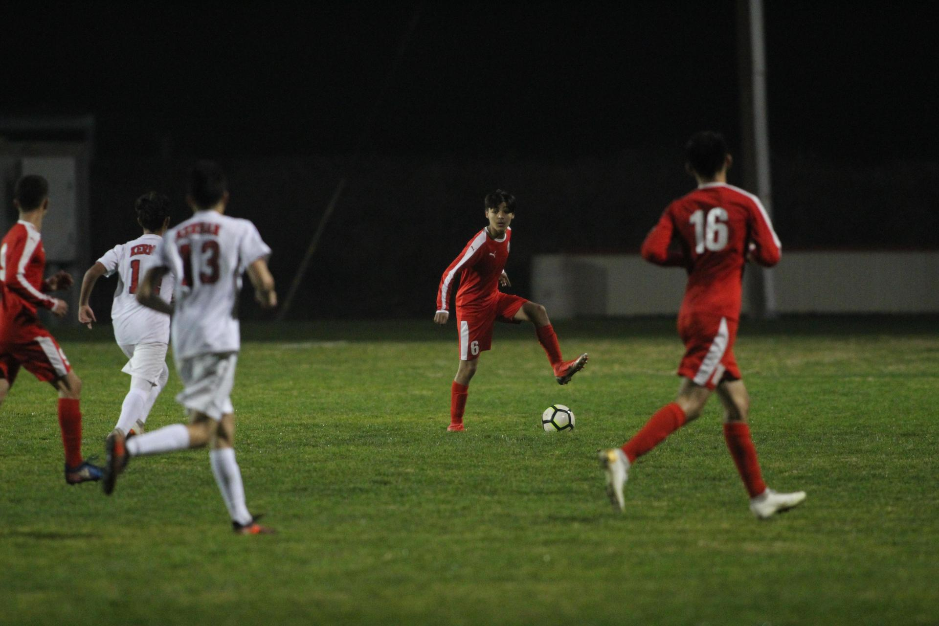 Boys Playing Soccer vs Kerman