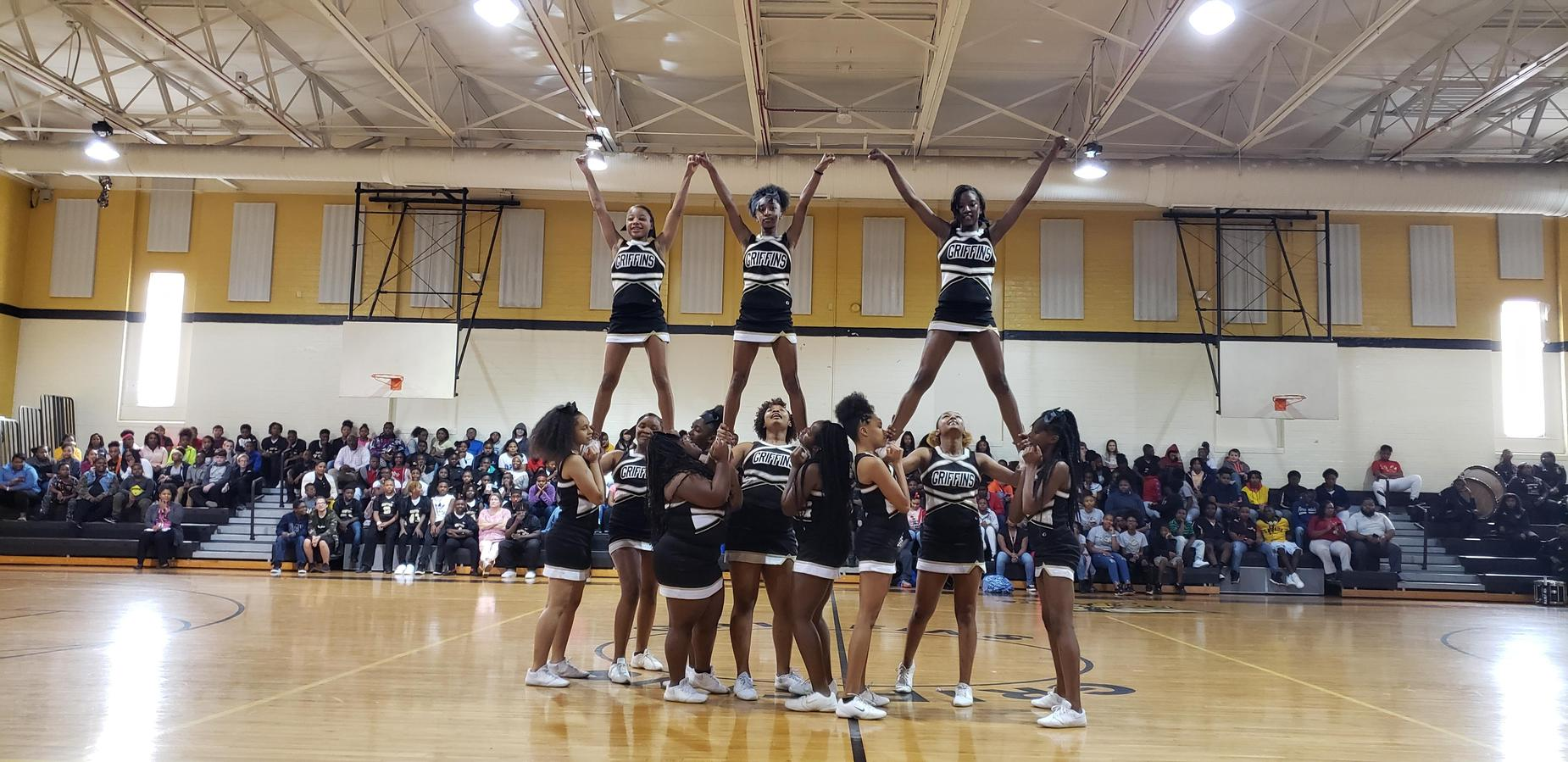 Cheerleaders in a pyramid at Pep Rally