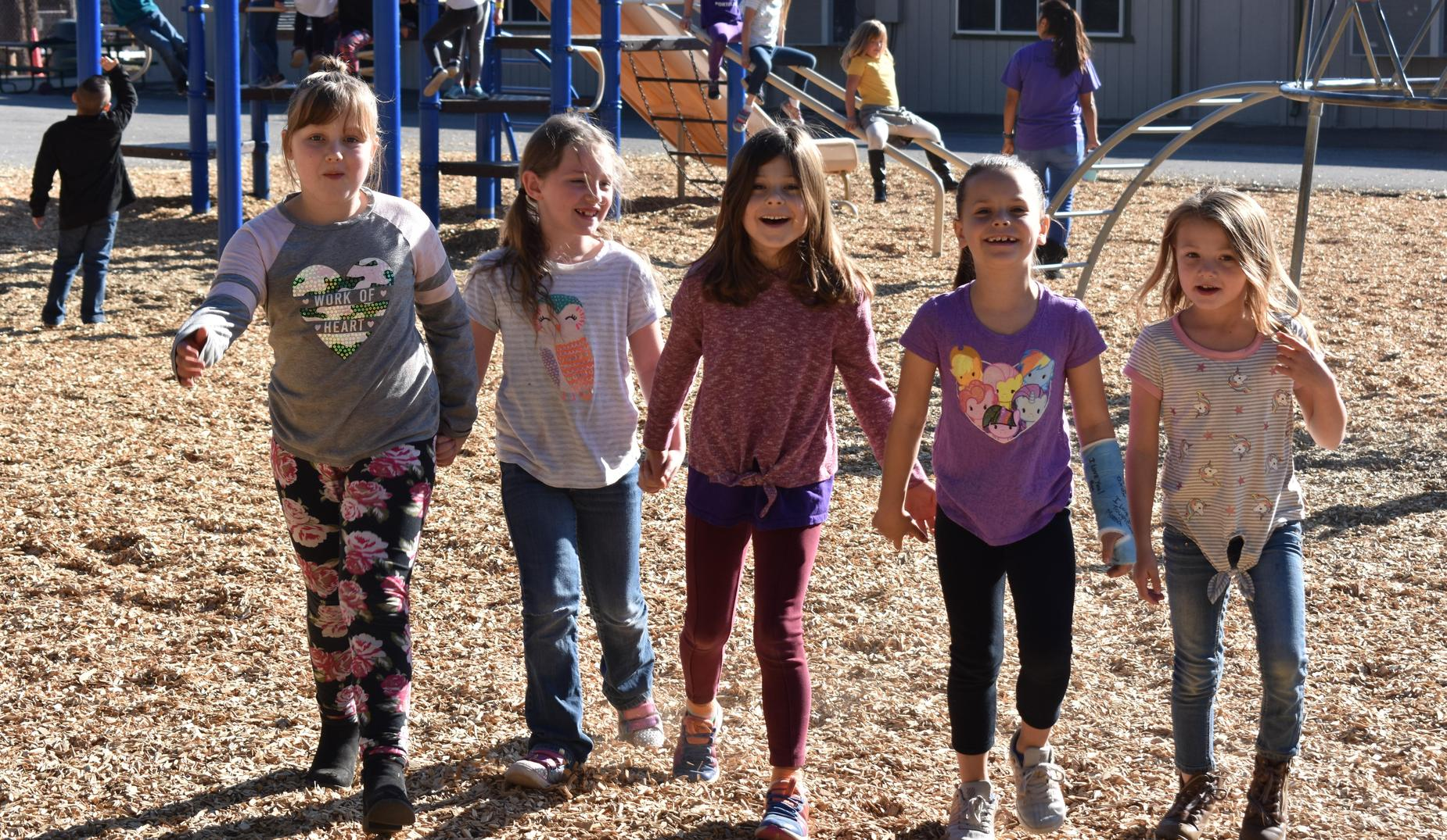 2nd grade friends on the playground