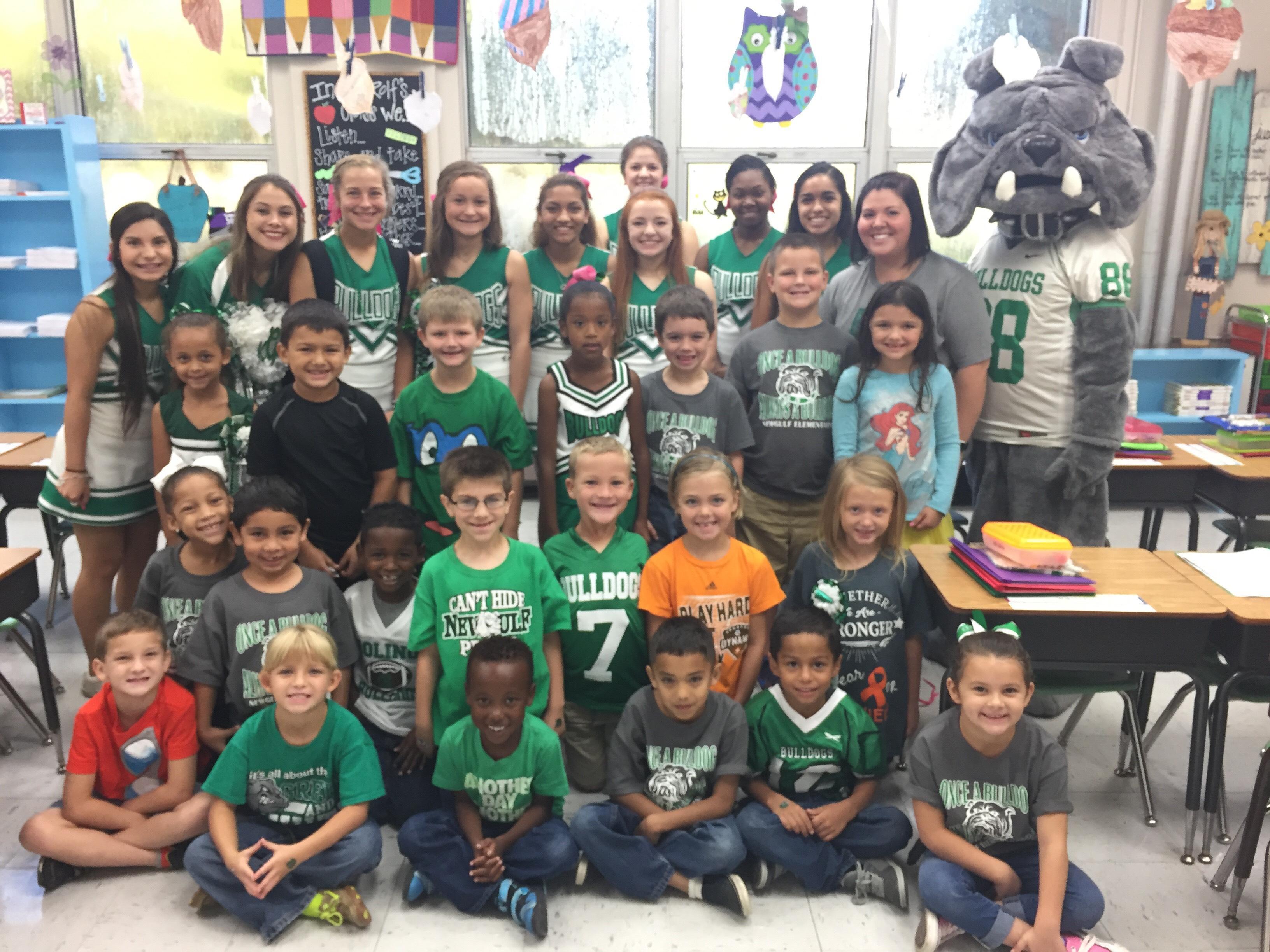 children with cheerleaders and mascot