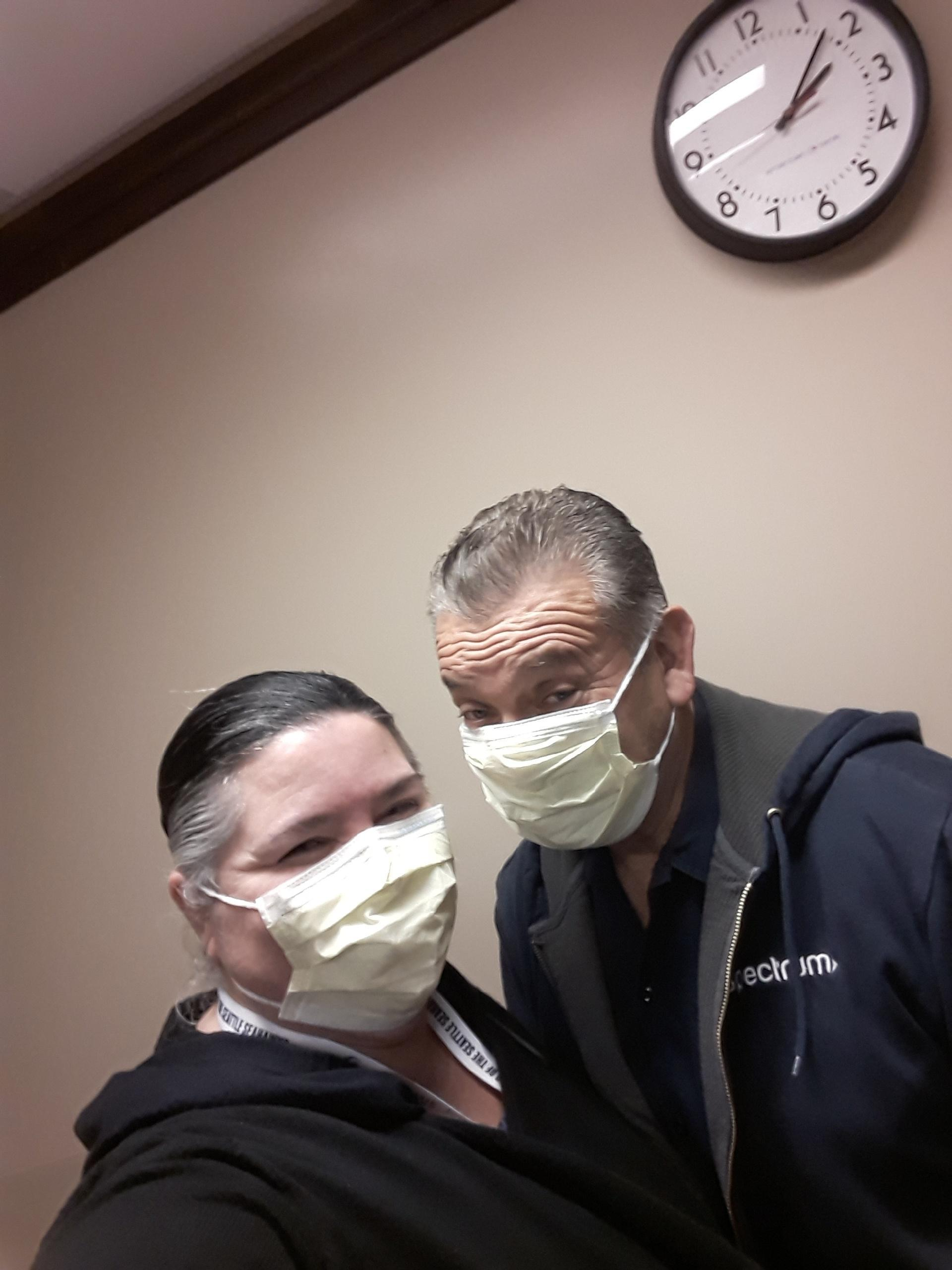 staff member with family member wearing mask