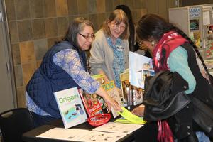 Yakima Valley Libraries representatives at Healthy Choices Fair talking to families