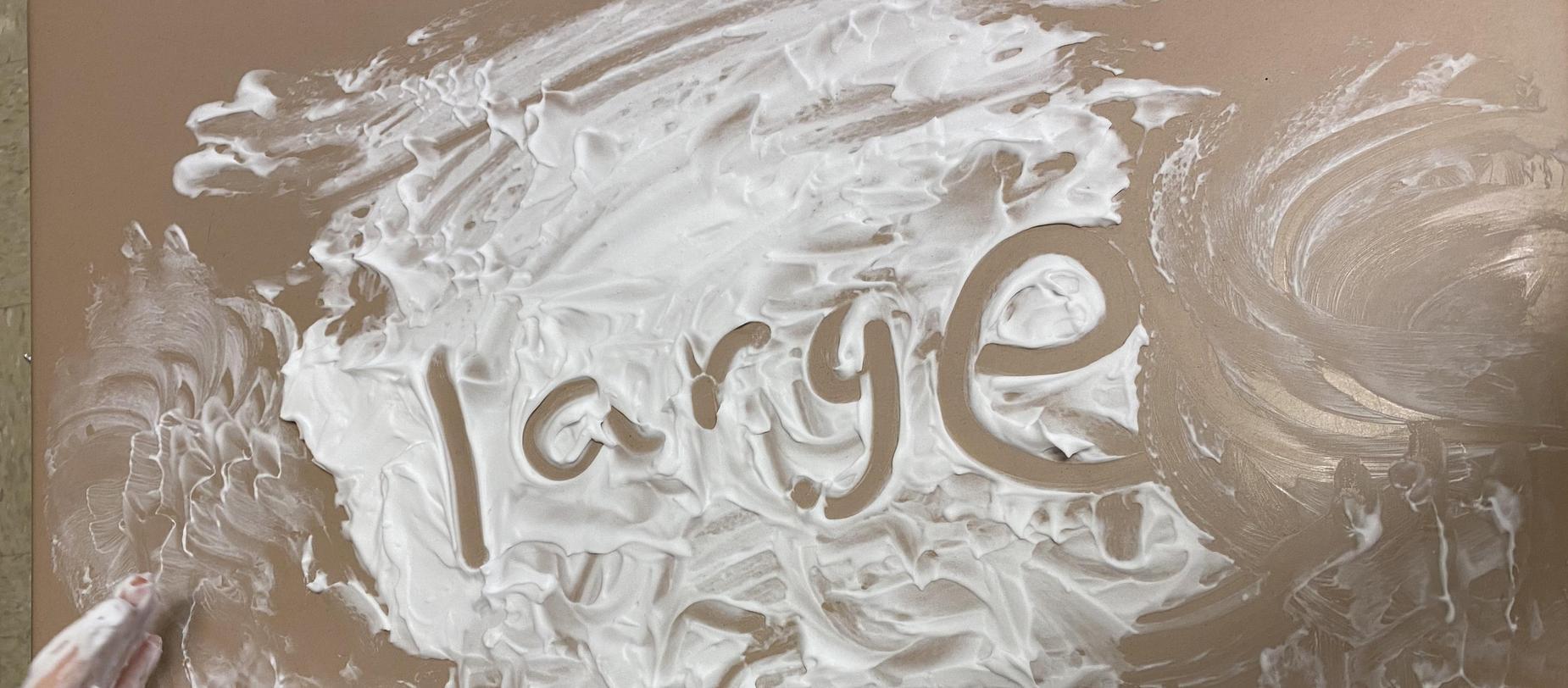 the word 'large' written in shaving cream