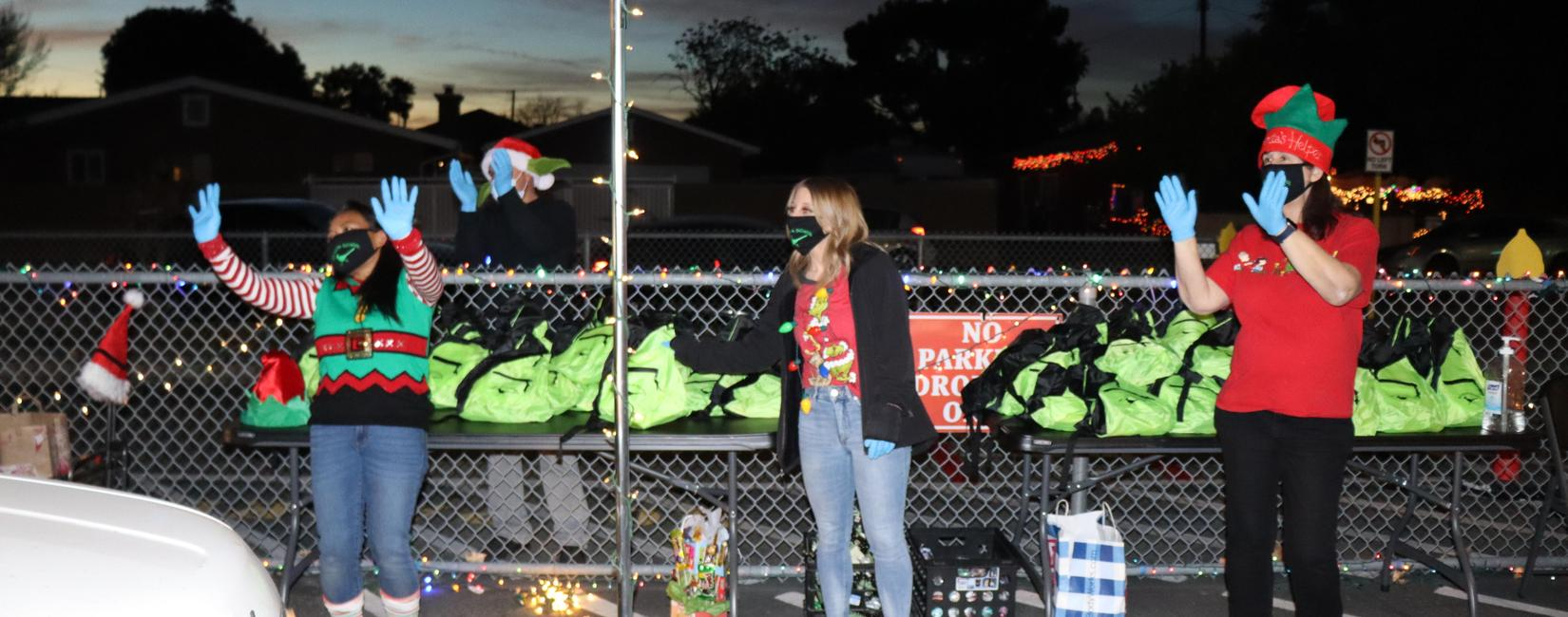 Staff at Rio Vista greet students at Holiday Parade