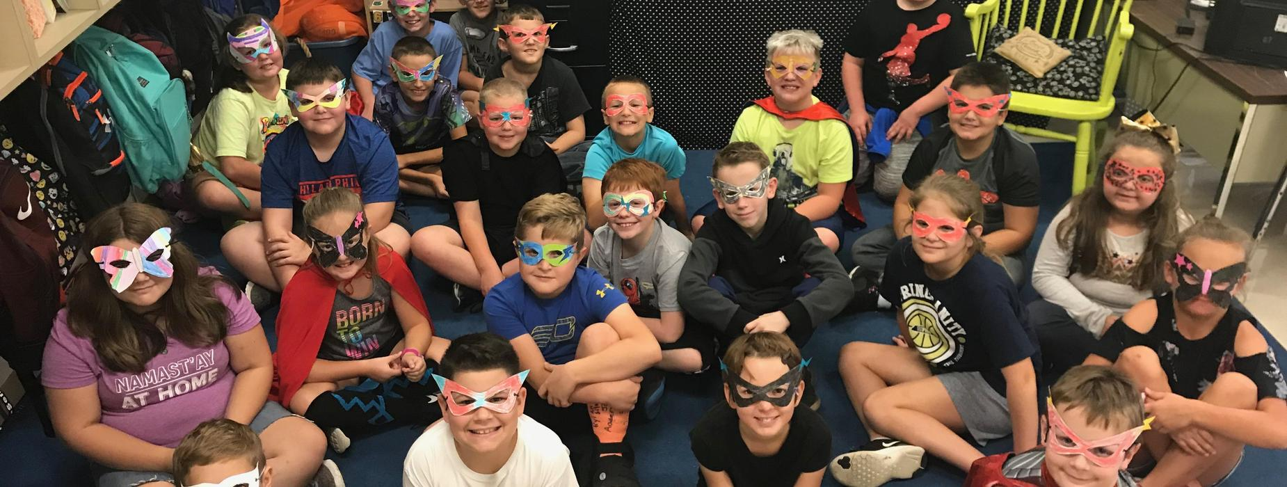 Mrs. Plemons's Class wearing superhero masks they made at Walk-a-Thon