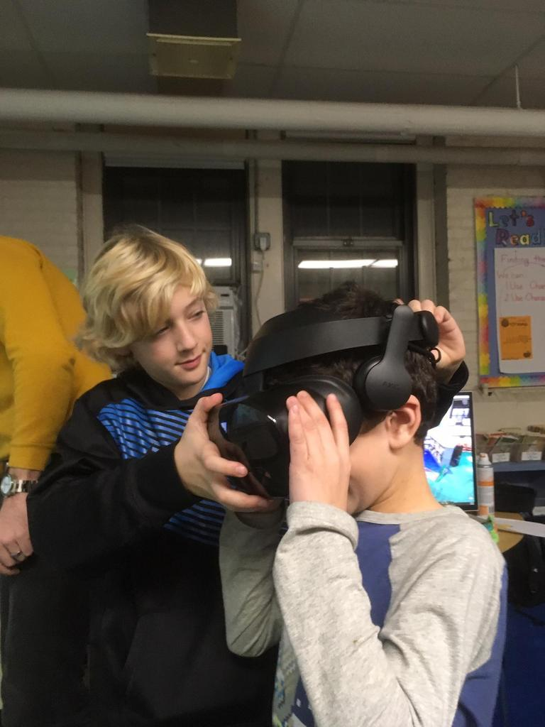 Photo of students trying virtual reality at McKinley's annual STEM Night.