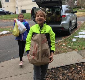 The Early Act Club of Jefferson School coordinated a food drive to help those less fortunate.  Members of the club and their advisors, along with Jefferson principal Dr. Susie Hung (upper left), delivered the food items on Nov. 20 to Grace Presbyterian Church.  Picture here are two members of the club helping to deliver the food.