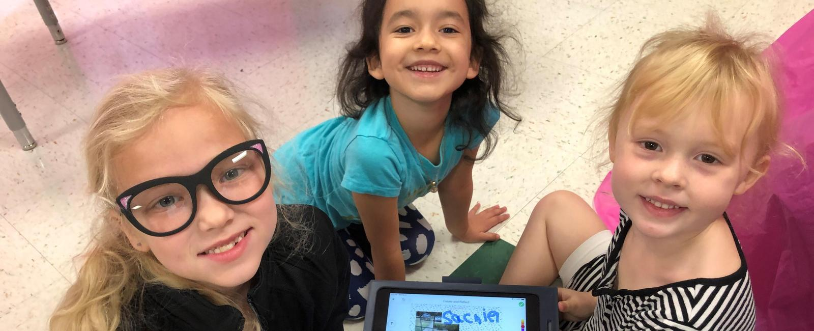elementary students working with technology