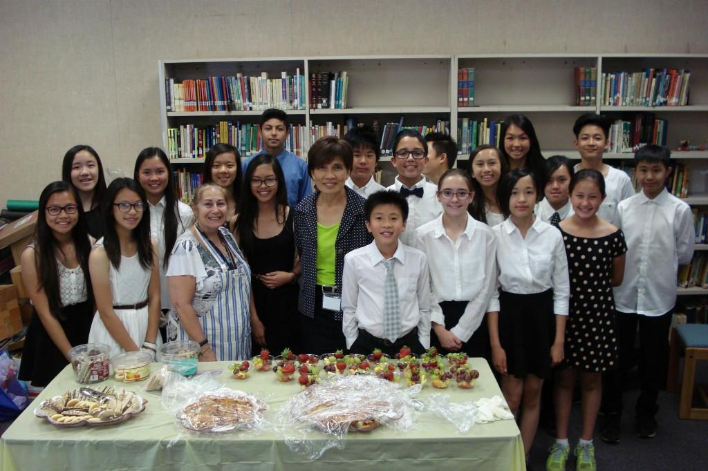 Marguerita students gather around during Volunteer Tea