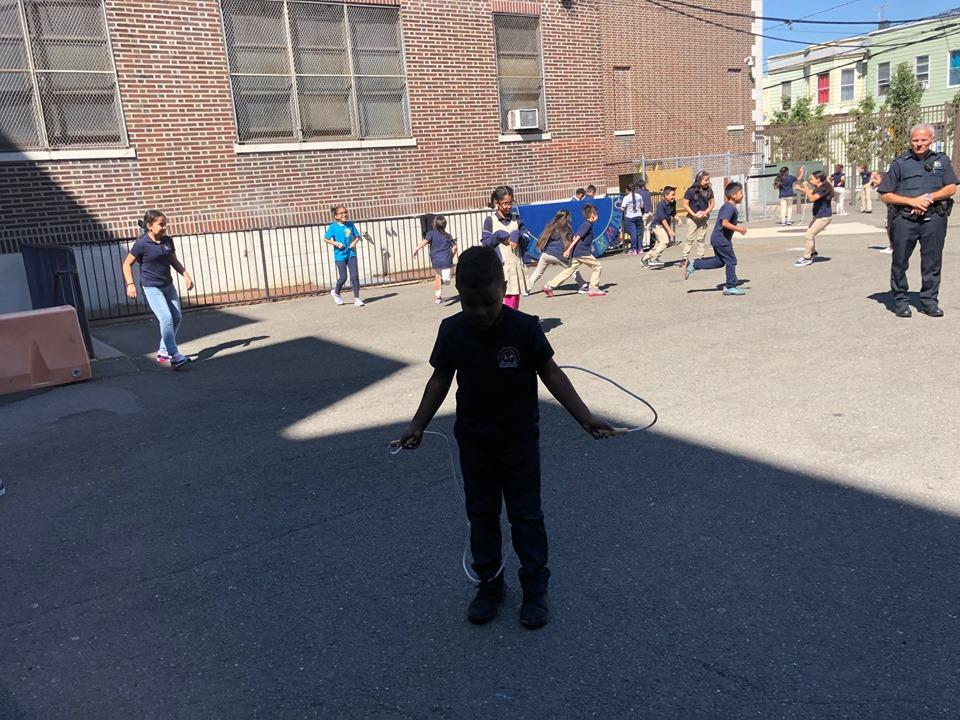 multiple children running around in the school yard