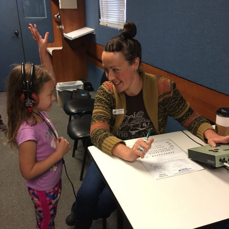 Kindergarten student taking a hearing test