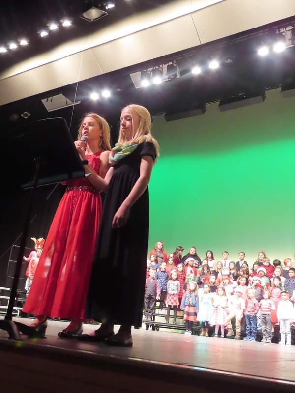 Two 5th graders speaking during the concert