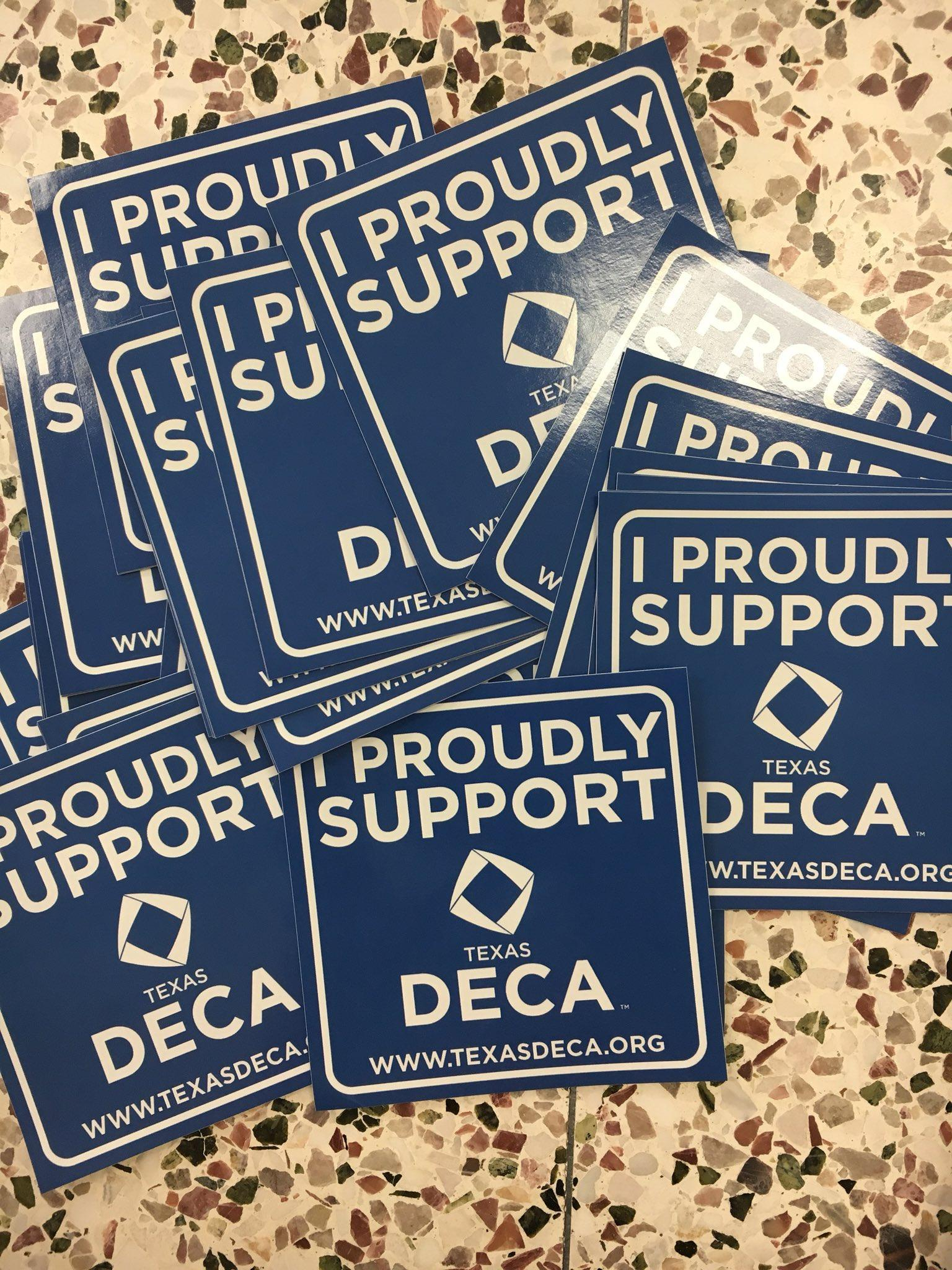 Scattered 'I proudly support DECA' signs