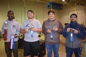 Precision machine students display ribbons