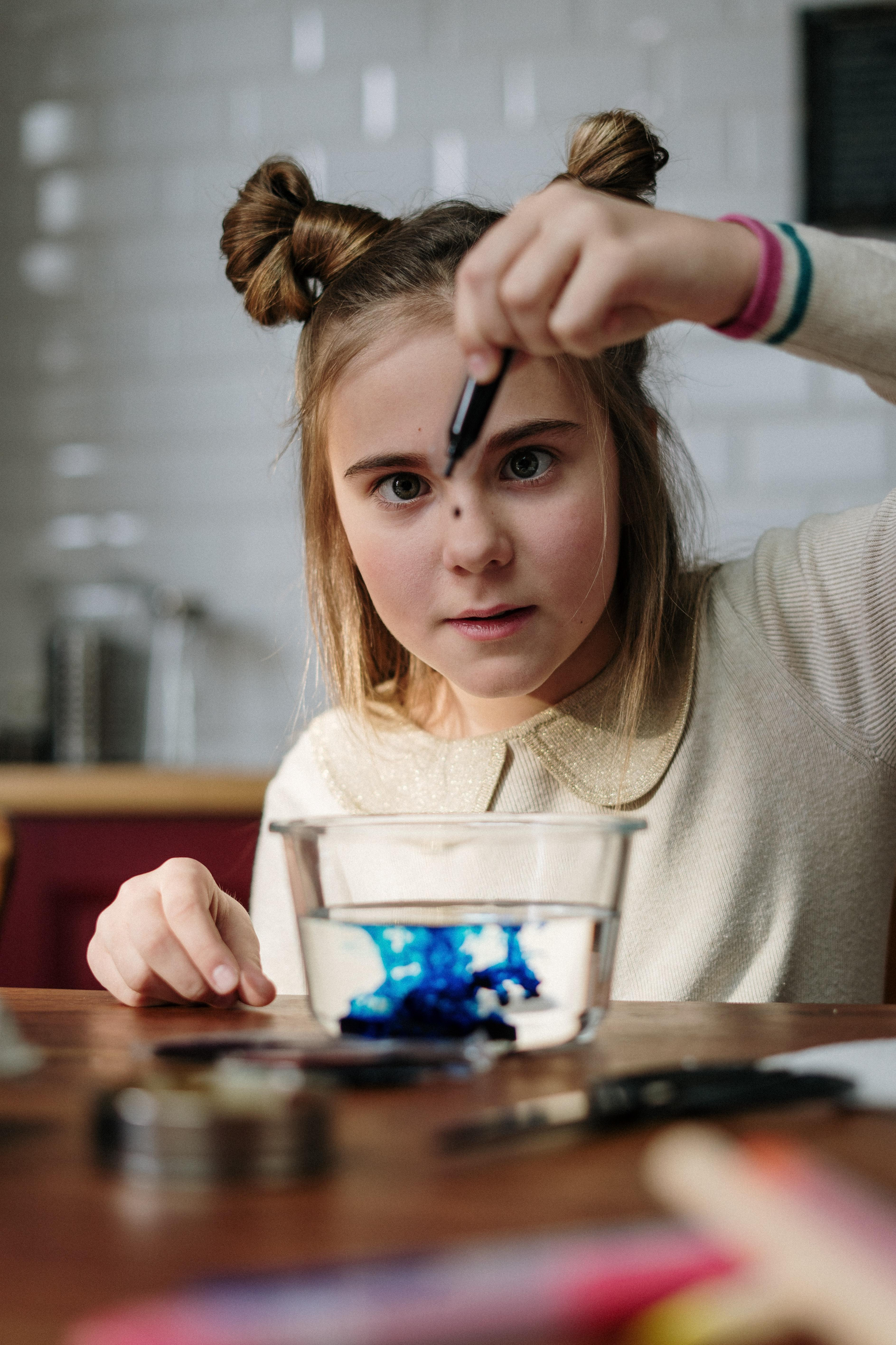 Girl performing a montessori science experiment