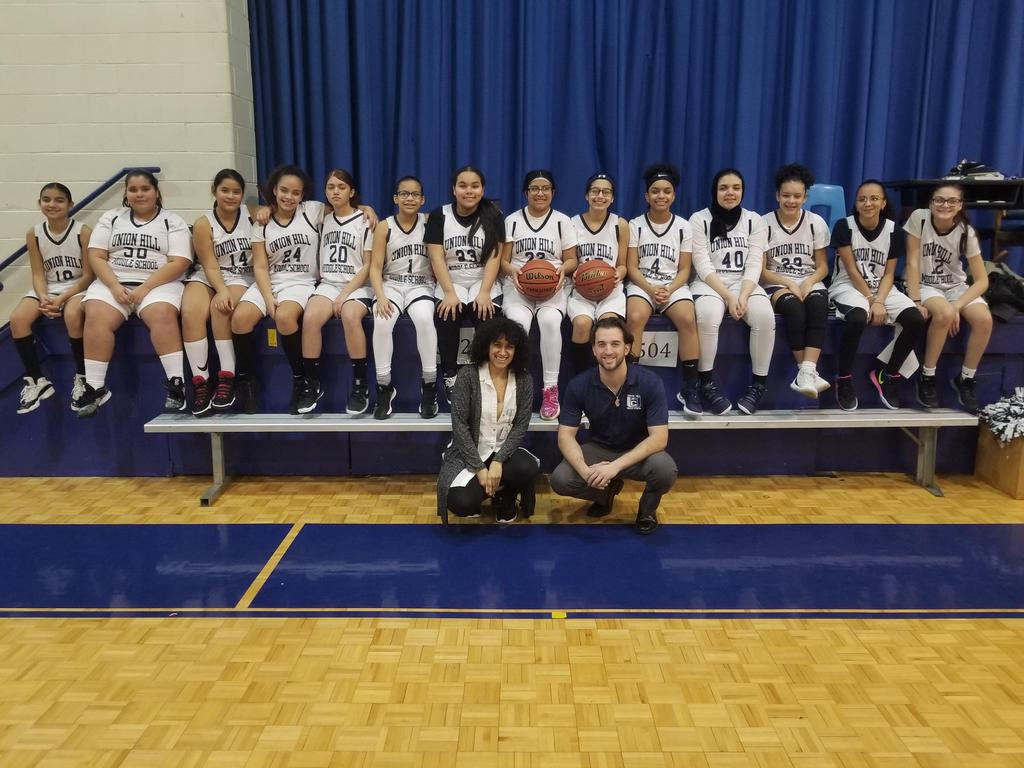 UHMS Girls Basketball Team with Coaches in front of the girls
