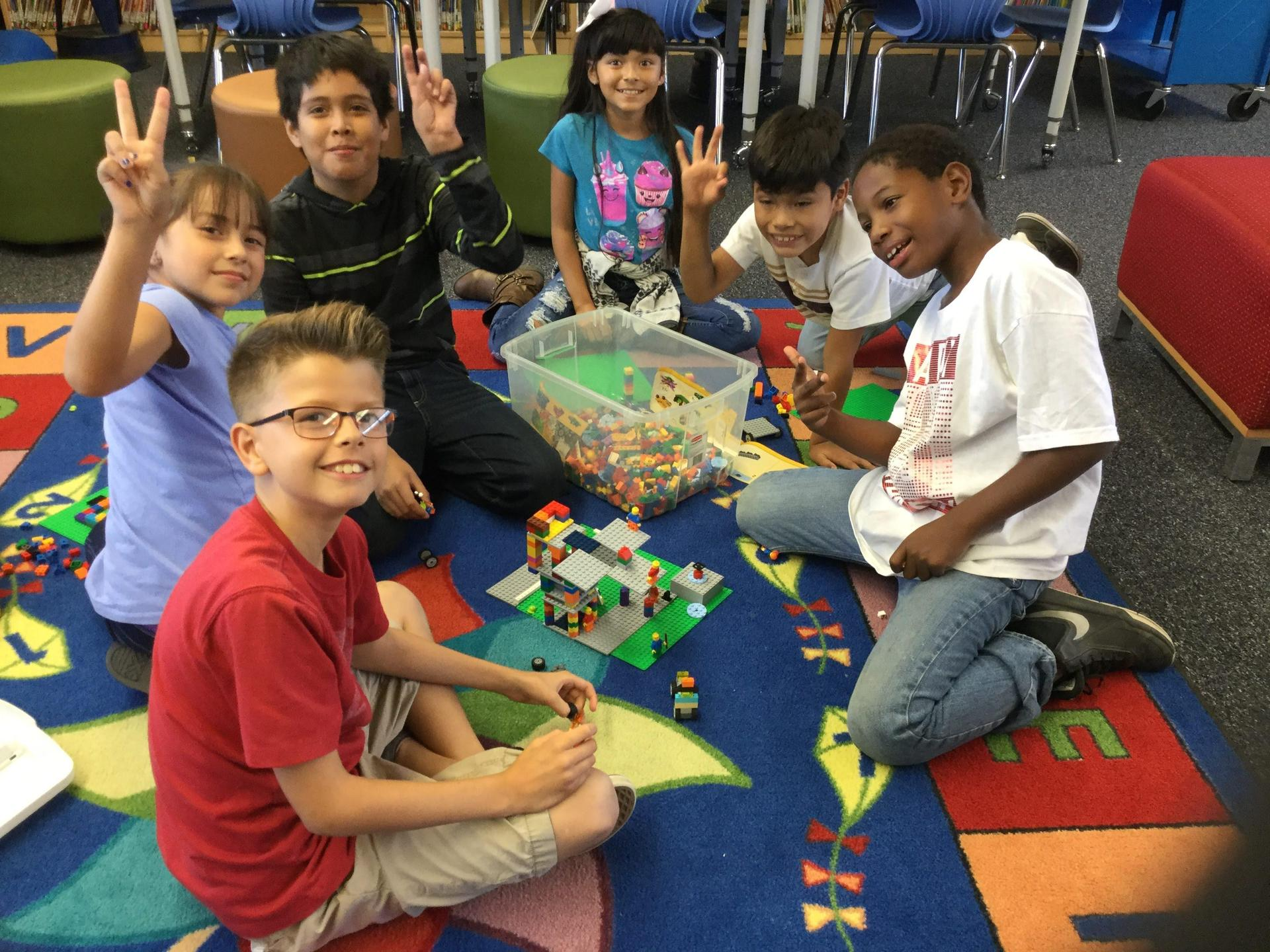 Students building with Legos
