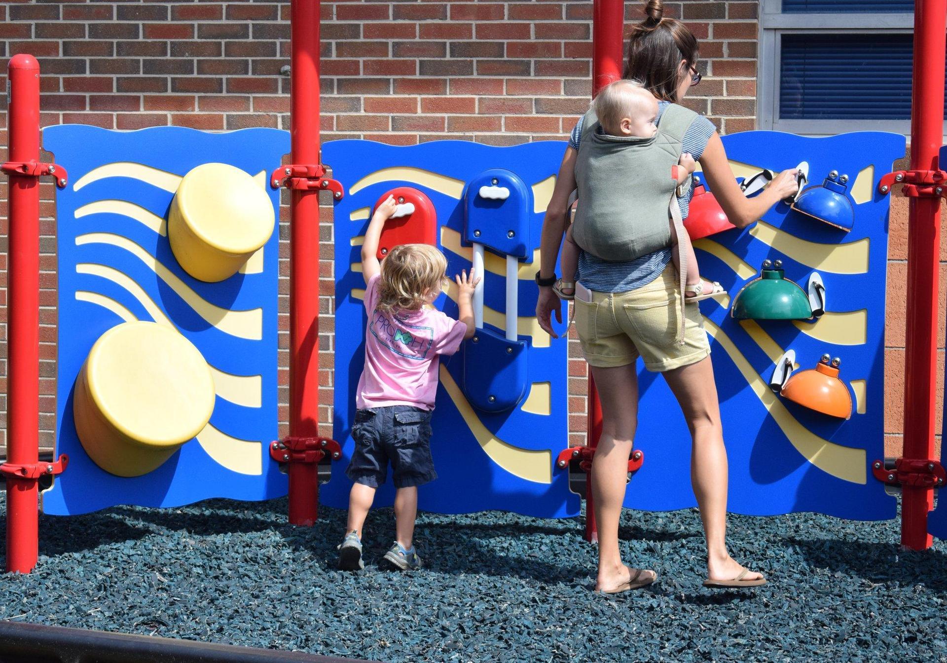mom and child at musical playground