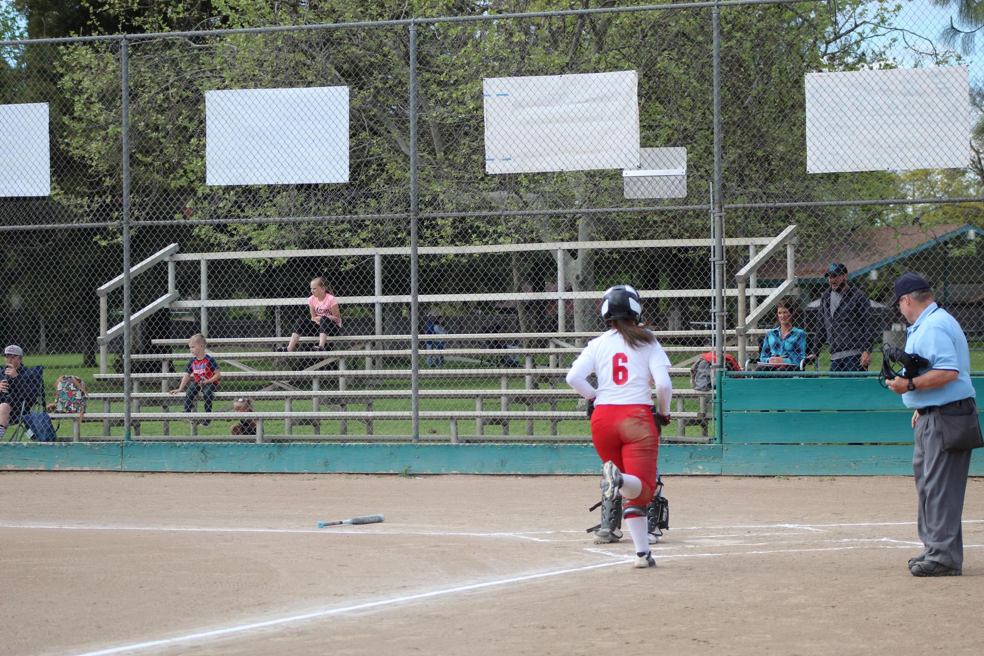 Girls playing softball against Yosemite